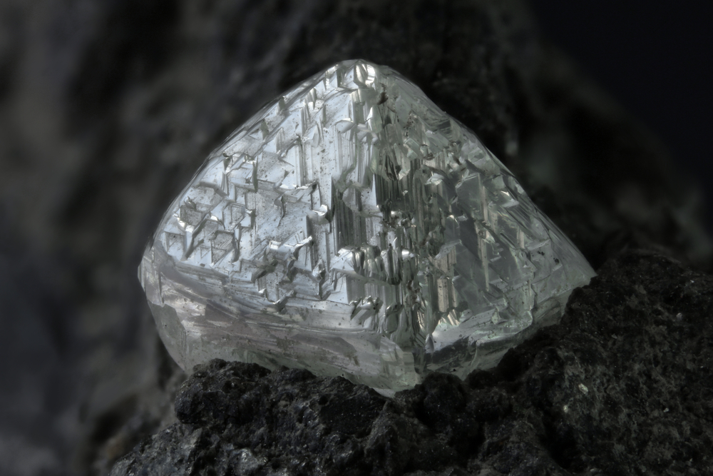 Diamonds form deep within the Earth, and then travel to the surface within volcanic rocks, such as this kimberlite.